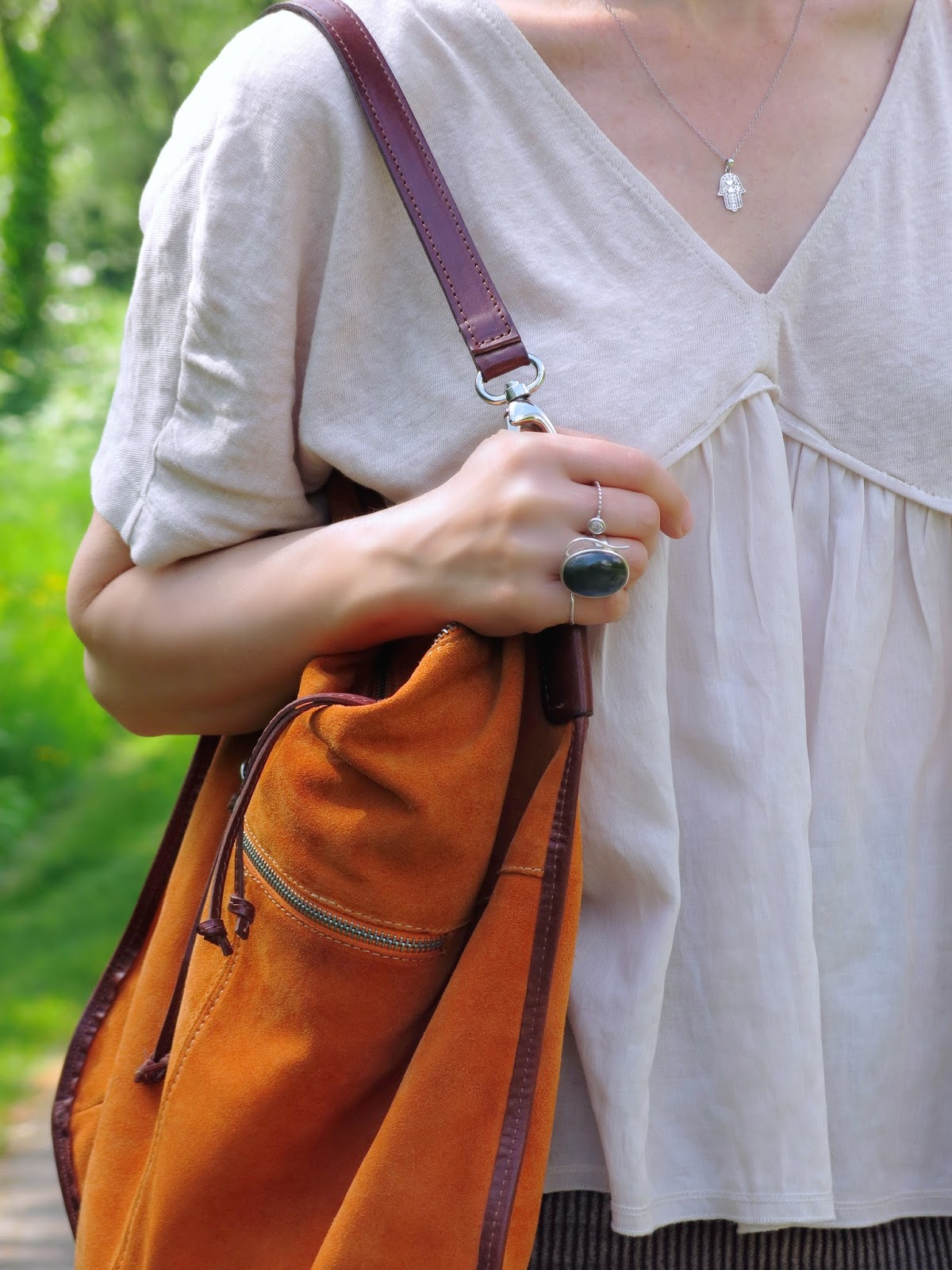 Zara top, orange bag, hamsa necklace, labradorite ring