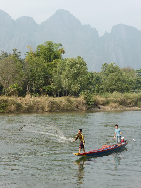 Children Fishing with nets in Vang Vieng, Laos