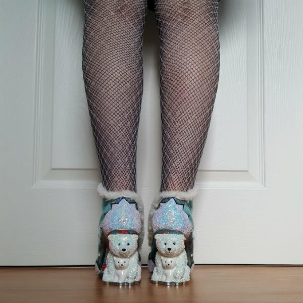 back view of white glitter polar bear heels on shoes with white furry trim
