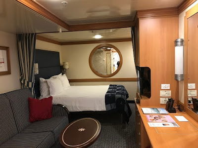 Inside deluxe stateroom on the Disney Magic cruise ship