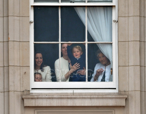 Prince George at the window of Buckingham Palace with nanny Maria Teresa Turrion Borrallo Trooping the Colour ceremony,
