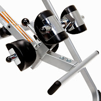 Spring-loaded ankle locking system on the Ironman Gravity 1000 Inversion Table with ergonomically molded ankle cushions