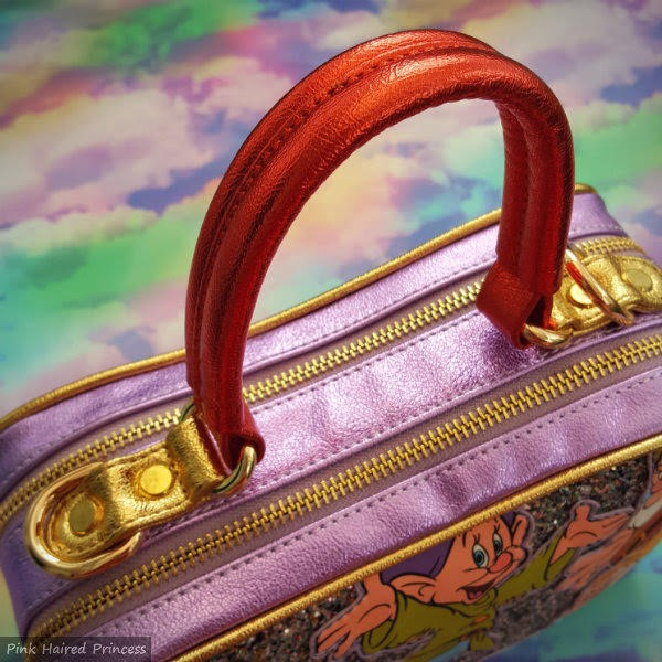 close up of red metallic short handle on lilac metallic bag