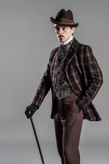 Men's Victorian Era Clothing. Historically Accurate. Brown plaid jacket, checked waistcoat, ascot/cravat, hat, pants, gloves and cane. men's steampunk clothing.