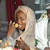 Lovely photo of Nigerian lady feeding husband's 2nd wife on their wedding