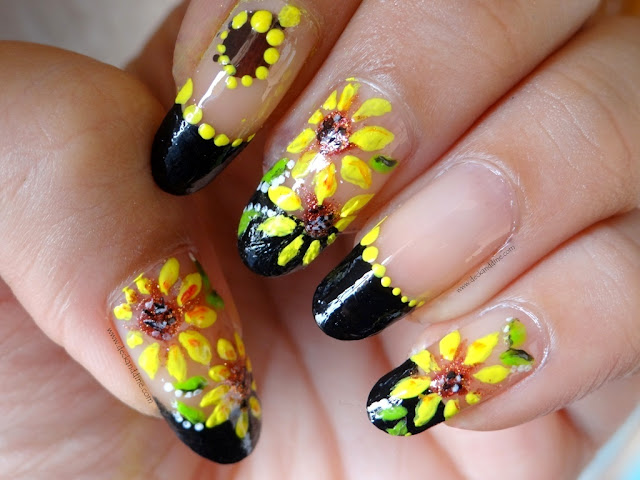 So today I thought of doing a summery sunflower nail art. It is so easy to  do and I hope you enjoy this sunflower nail art design! - Summer Sunflower Nail Art Step-by-Step Tutorial - Deck And Dine