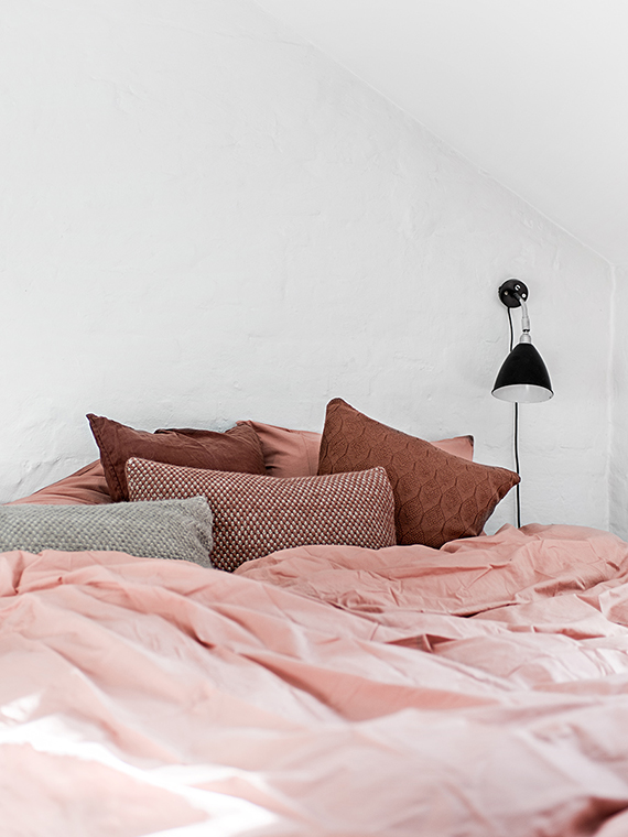 Bed with pin bed linen via Cereal. Photo by Peter Kragballe, styling by Camilla Tange Peylecke
