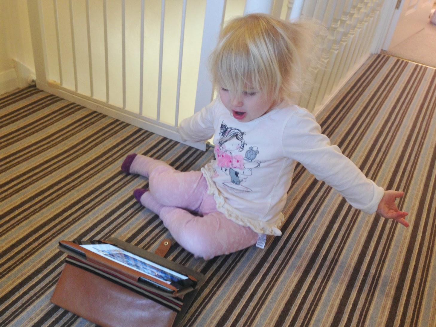 Unhappy looking Tin Box Tot watching YouTube on iPad