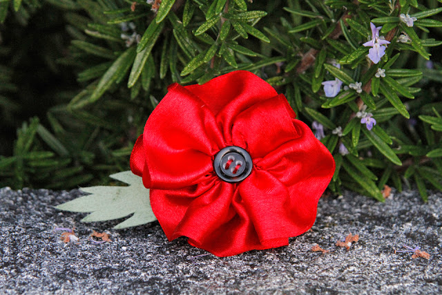 DIY rolled ribbon poppy of remembrance