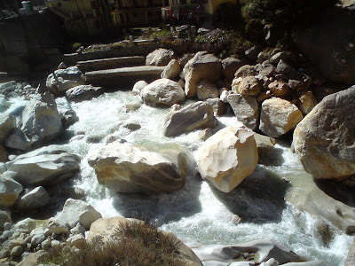 The holiest river of India - The Ganges glistening in the sun at Gangotri - Char Dham