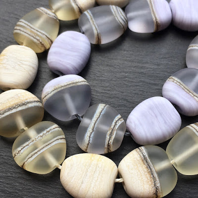 Tumble-etched lampwork glass pebble beads by Laura Sparling