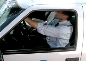 A man driving at a very high speed.