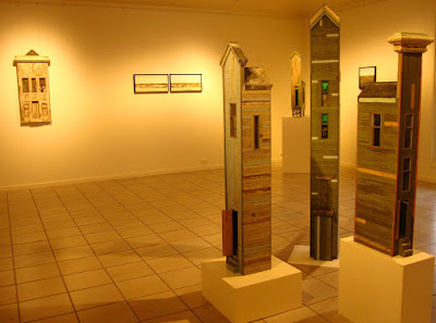 View of four of the buildings on display at the Alex Asch exhibition at Beaver Galleries.