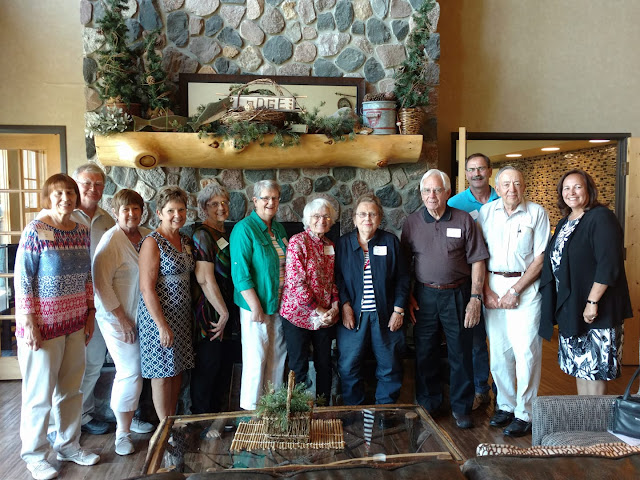 Group of retiree with Dean Bev Durgan