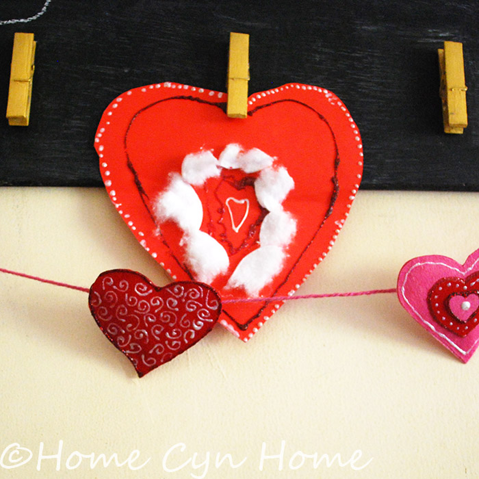 Let your kids decorate big red paper heart with glitter glue and cotton.