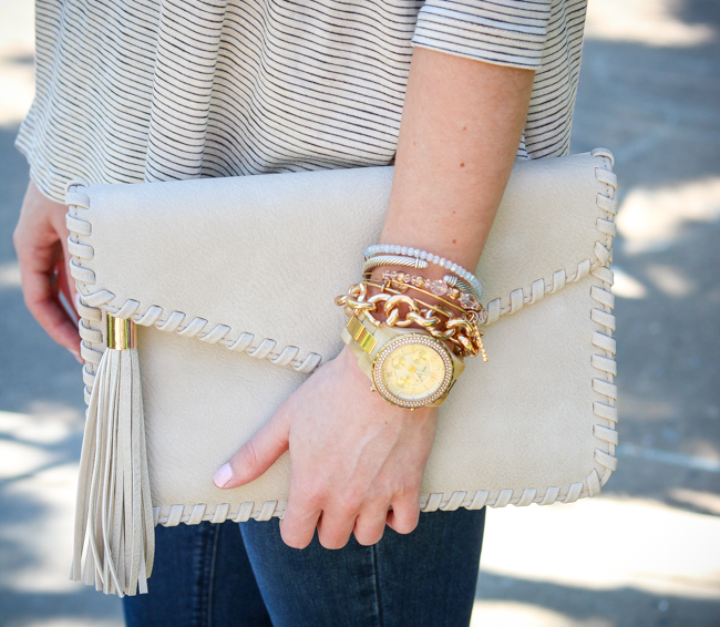 tan tassel clutch with gold j.crew bracelet
