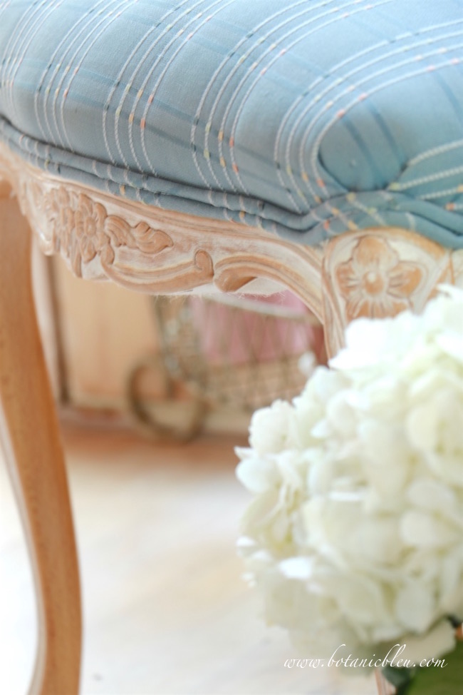 white-washed-carved-wood-frame-on-chair