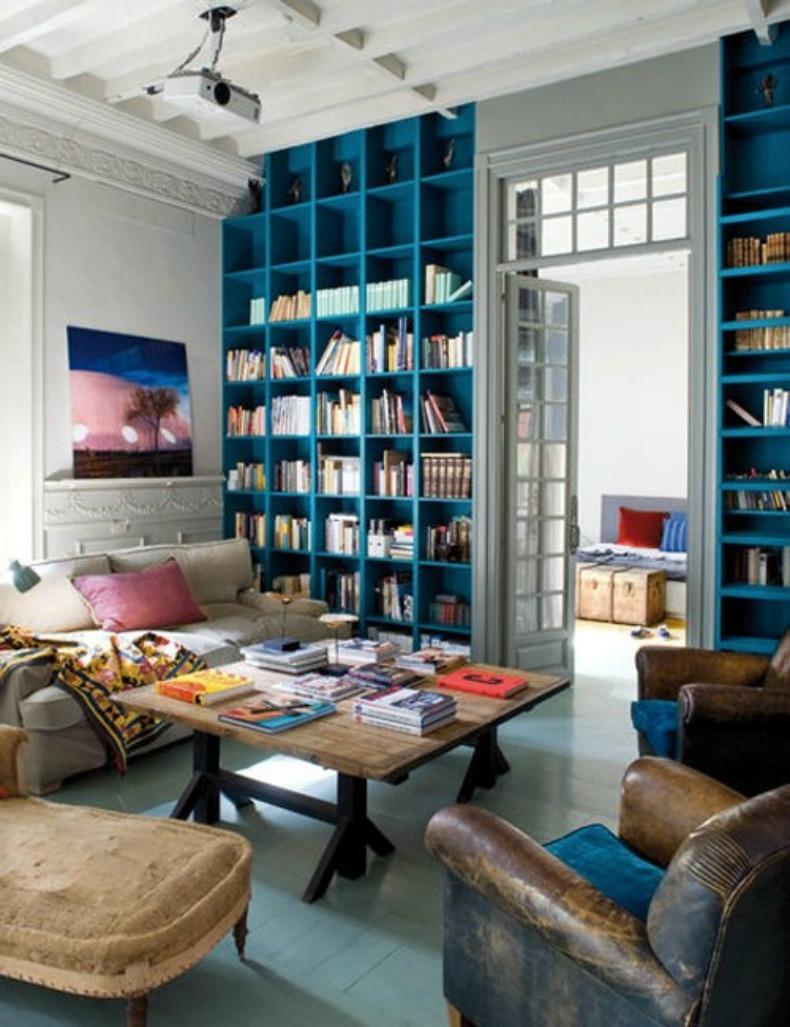 Coastal living room with library bookshelves painted bright aqua blue