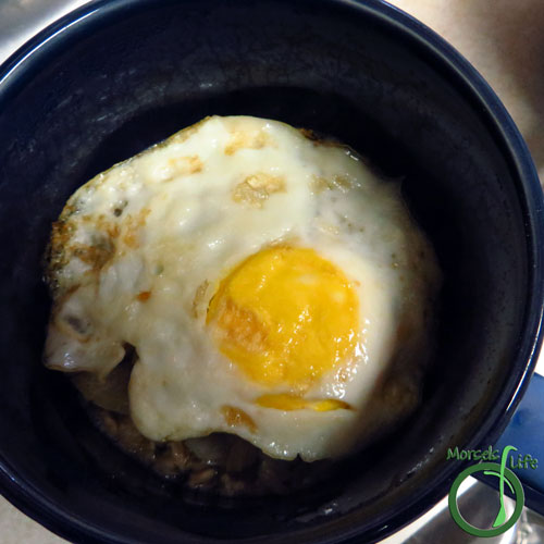Morsels of Life - Savory Oatmeal Step 6 - Top with egg. Eat and enjoy.