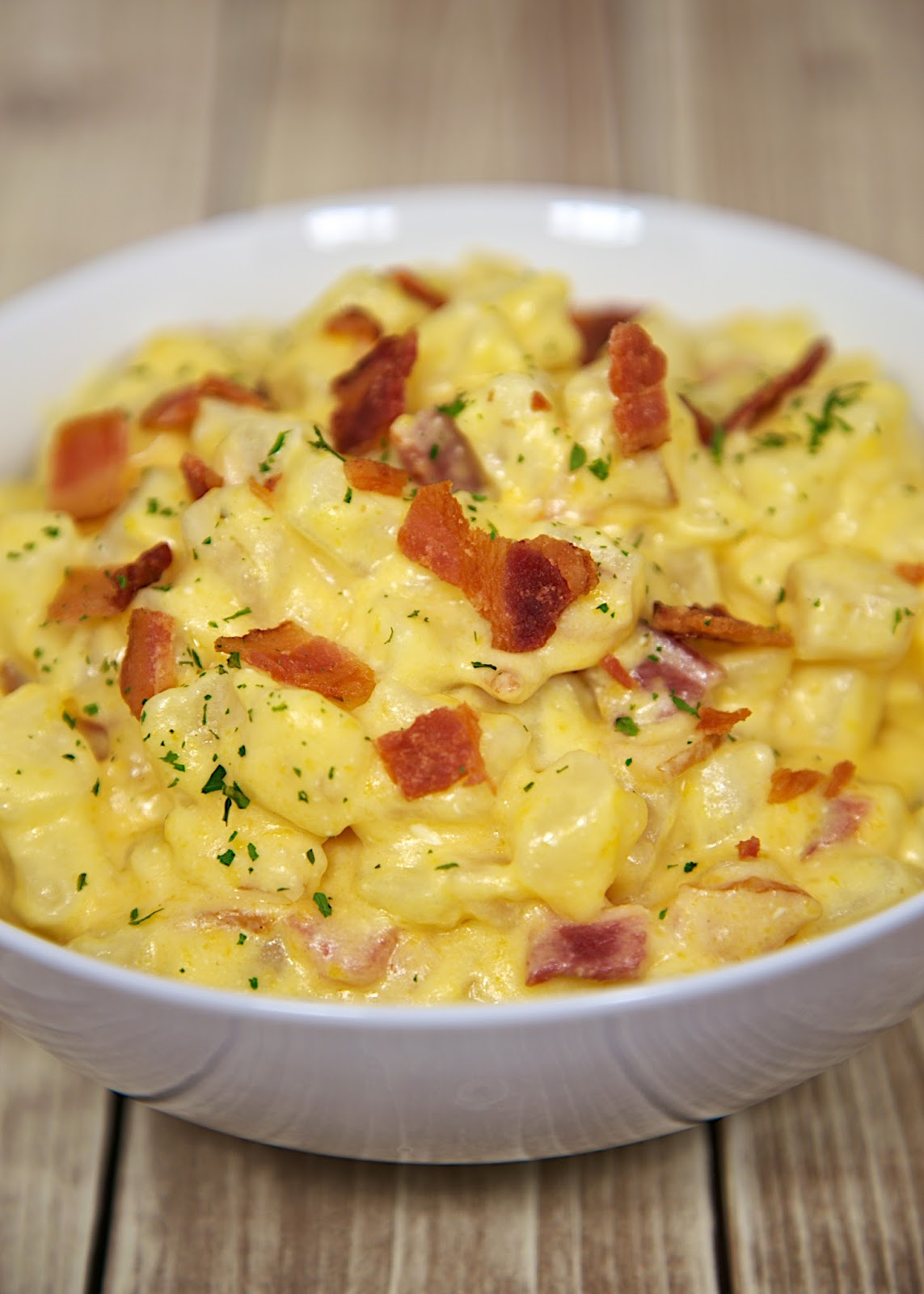 Slow Cooker Cheesy Bacon Potatoes Recipe - frozen hash browns, cheese, bacon slow cook all day for a delicious side dish!
