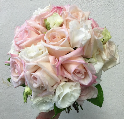Pink and white wedding bridal clutch bouquet by Stein Your Florist Co.