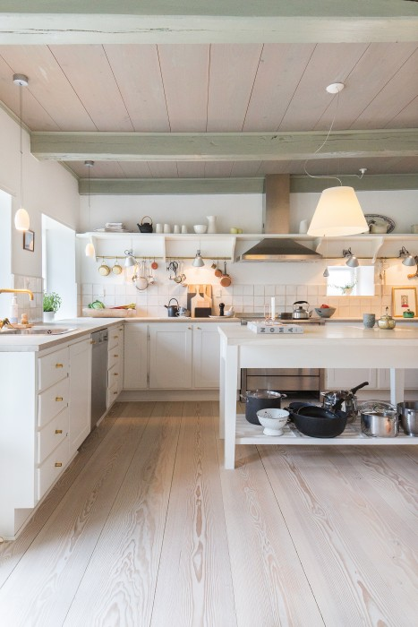 Breathtaking European farmhouse kitchen with exquisite wood floors by Dinesen on Hello Lovely Studio