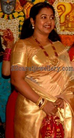 Radhika With Ruby Emerald Beads Long Chain Jewellery Designs