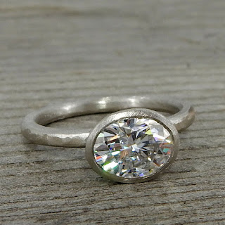 oval moissanite palladium ring