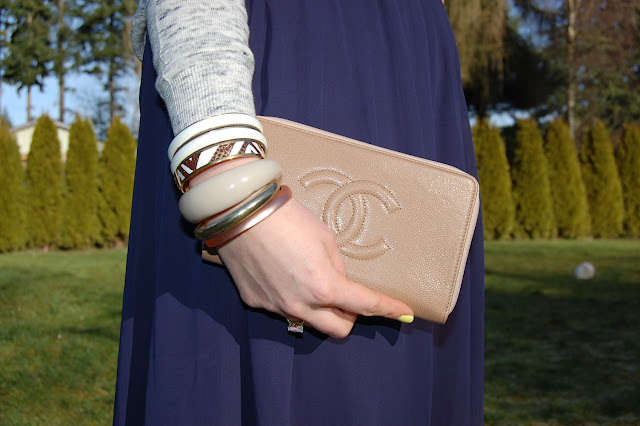 Chanel wallet, Coach bangle, Alexis Bittar