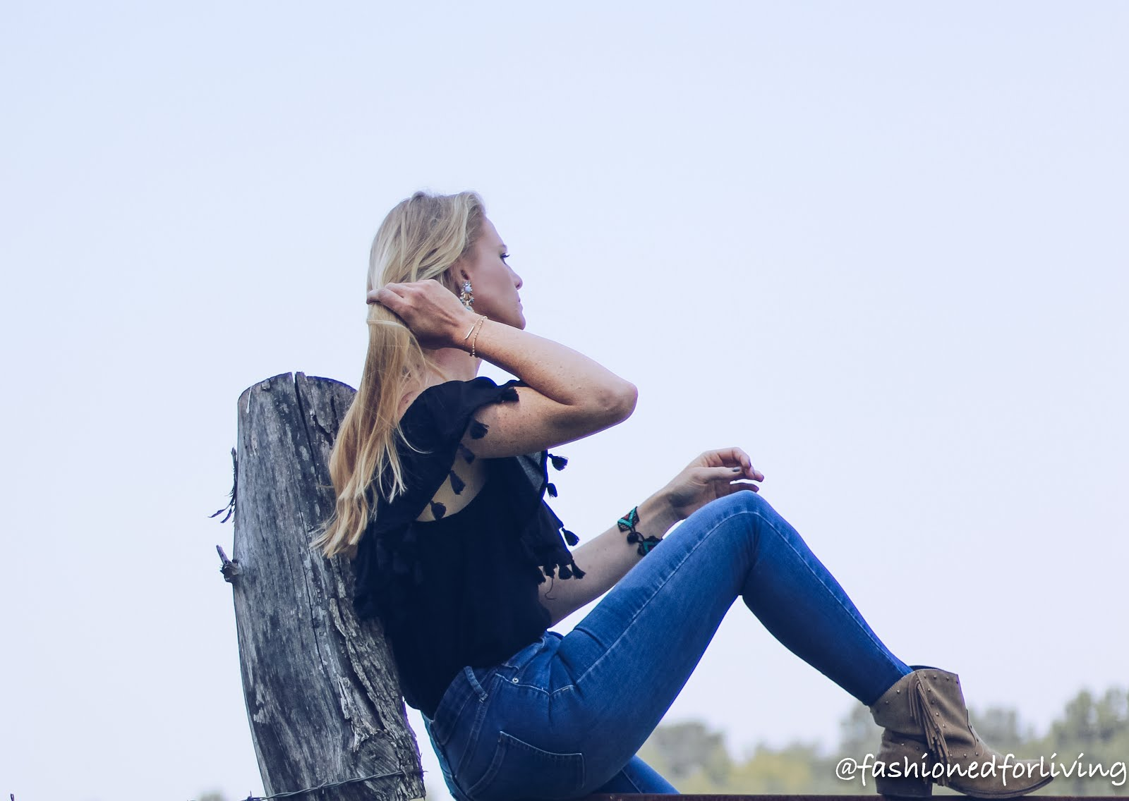 off the should tassel top with skinny jeans and fringe cowgirl boots
