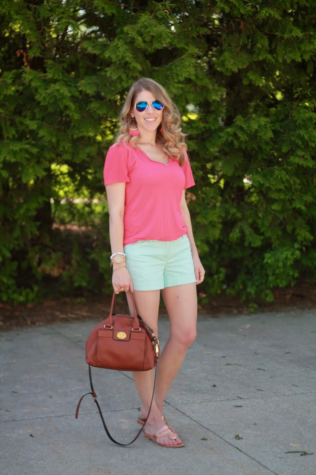 coral piko top, mint shorts, rose gold jack rogers sandals, cognac crossbody