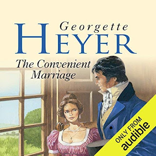 The Convenient Marriage audiobook cover. A man in a blue regency jacket and white shirt stands beside a wondow, watched by a woman in a pink regency gown trimmed with white lace.