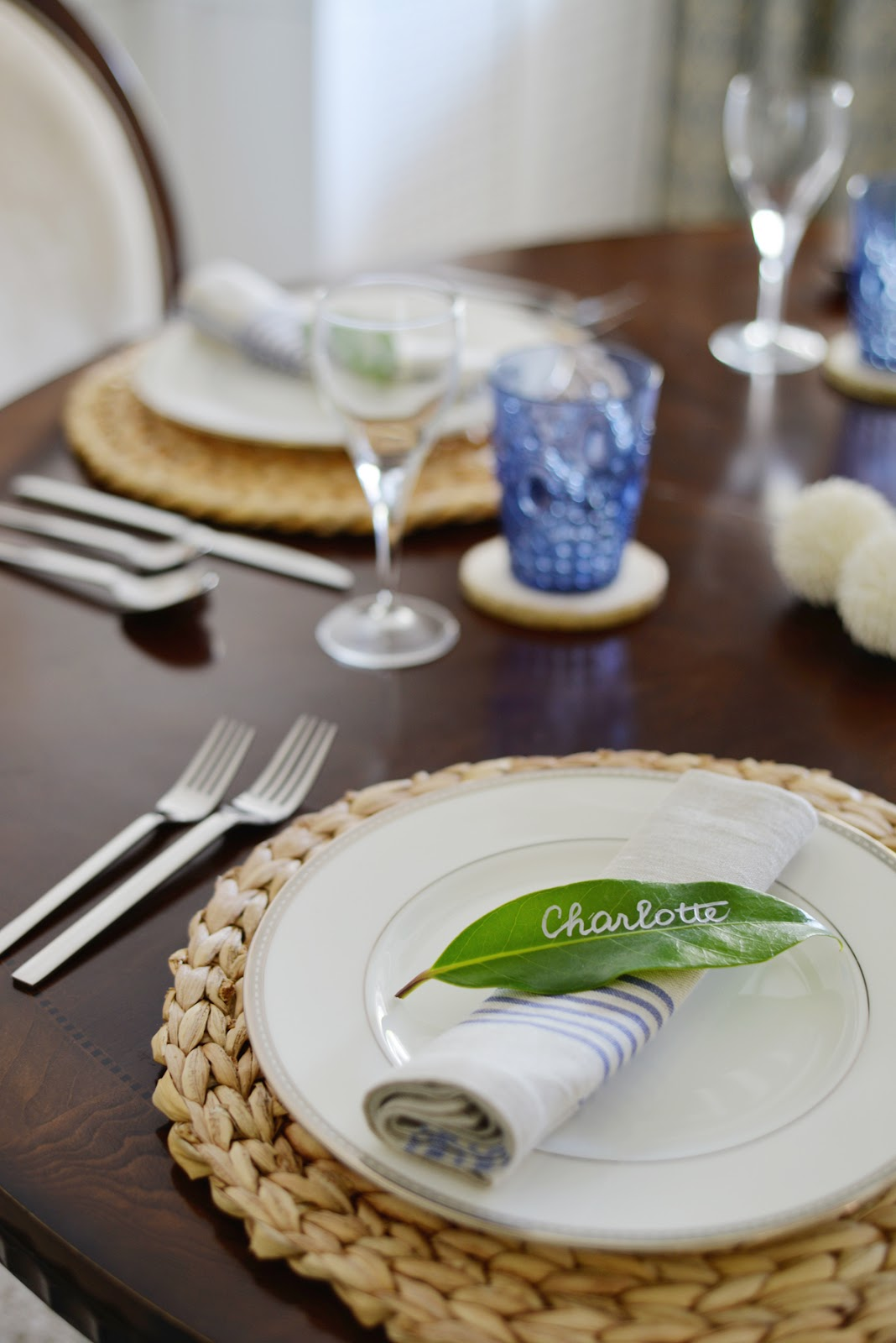 Rambling Renovators | tropical dining room with rattan charger, leaf placecard
