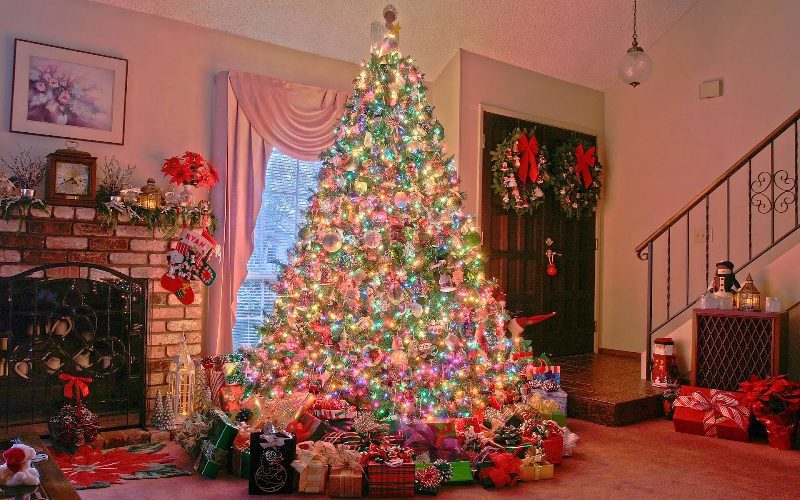 Beautiful-glowing-christmas-tree-decorated-in-hall-near-brick-fireplace-complete-setup-pictures.jpg