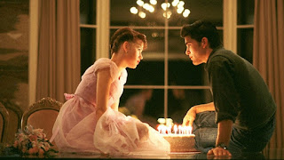 Sixteen Candles stars Samantha and Jake sit by a birthday cake