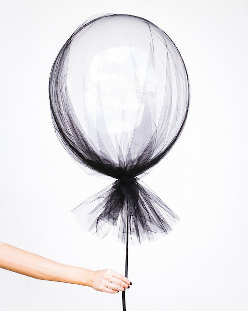A woman's white balloon by Hipster Mum via Unsplash.com