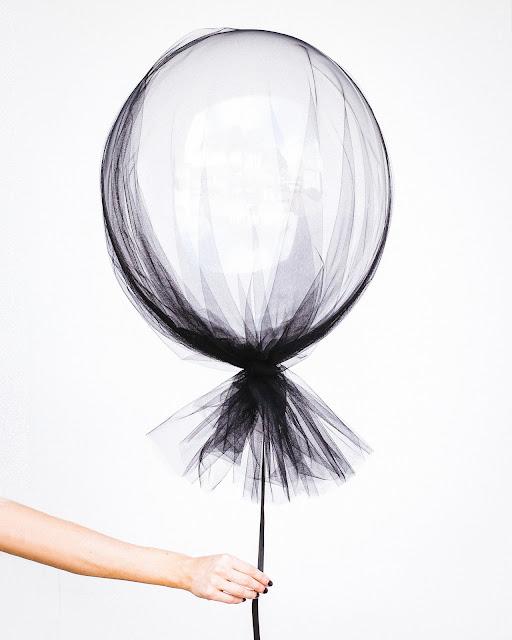 A woman's white balloon by Hipster Mum via Unsplash.com
