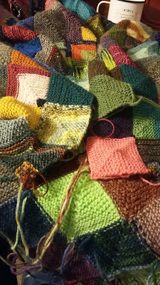 I'm knitting a mitered square blanket with scrap sock yarn.
