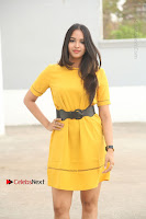 Actress Poojitha Stills in Yellow Short Dress at Darshakudu Movie Teaser Launch .COM 0027.JPG
