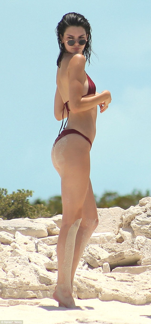 5fcfb785e9ed Cover girl: Kendall Jenner showed just why she's now one of the world's top  models as she rocked a skimpy burgundy bikini in Turks and Caicos