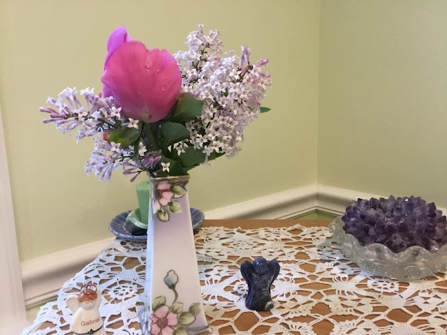 Bud vase with lilacs