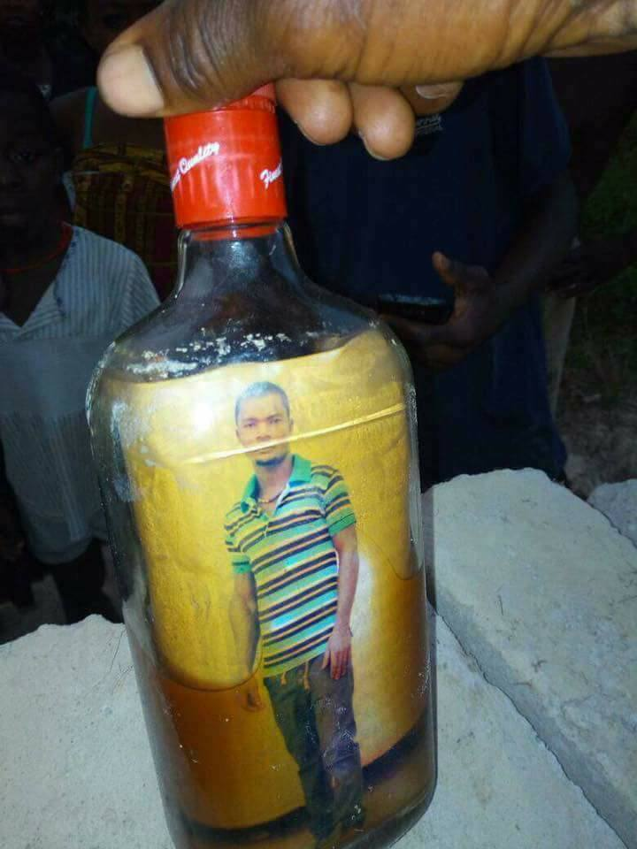 Voodoo Bottle Spell: Ghanaian Man Photo With Crucifix Found