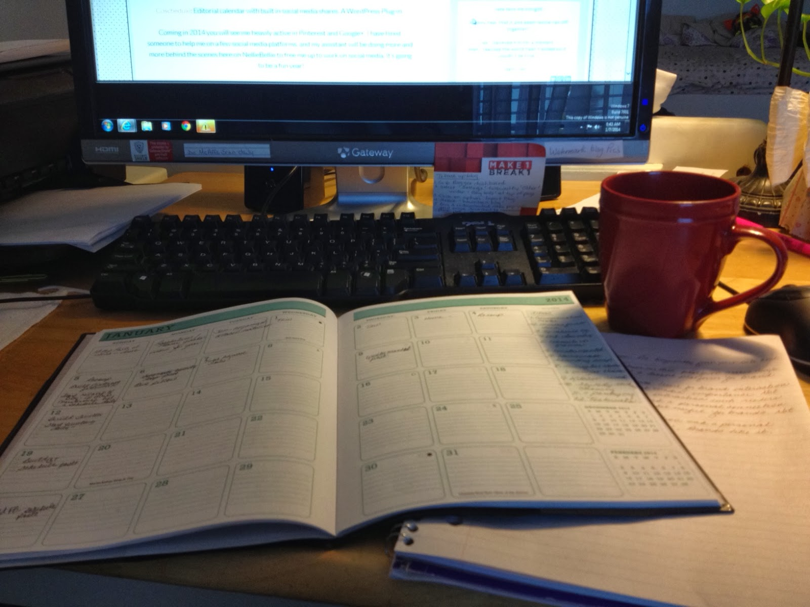 Computer, calendar, pen and coffee