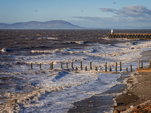 Photo of waves whipped up by high winds breaking on the shore at Maryport on Sunday