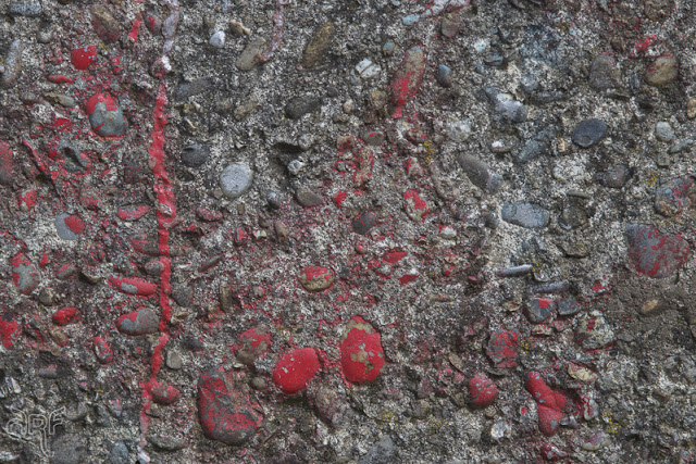 red paint on old concrete