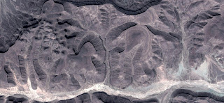 Fossilized landscape eggplant oasis on light colored stone, photo of abstract landscapes of deserts of Africa from the air