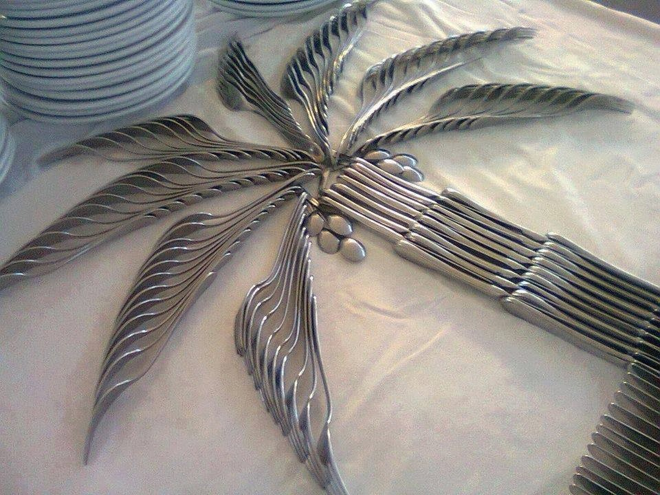 date palm made of spoons on table