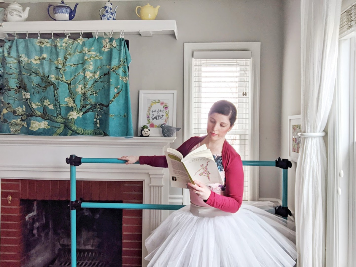 Dancer reading the ballet novel Cantique by Joanna Marsh