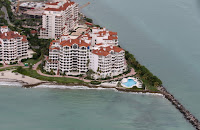 An oceanfront condo building is seen June 3, 2014 in Miami, Florida. According to scientists, the South Florida coast faces frequent flooding by the end of the century because of sea level rise (Photo Credit: Joe Raedle/Getty Images) Click to Enlarge.