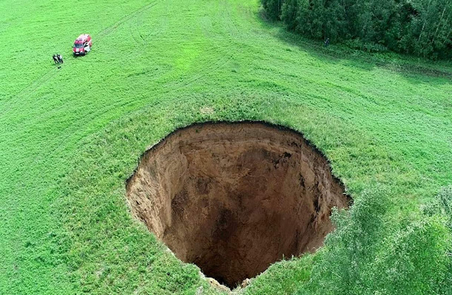 Massive 105-foot-wide Sinkhole Abruptly Appears in Russian Field